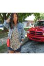 Red-purse-beige-shirt-blue-shorts-blue-jacket-silver-necklace-black-bo
