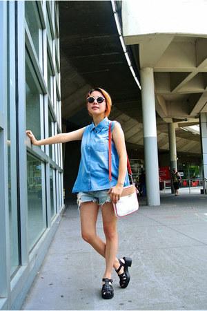 Levis jeans - Jag bag - apex sunglasses - Levis vest - Dr Martens sandals
