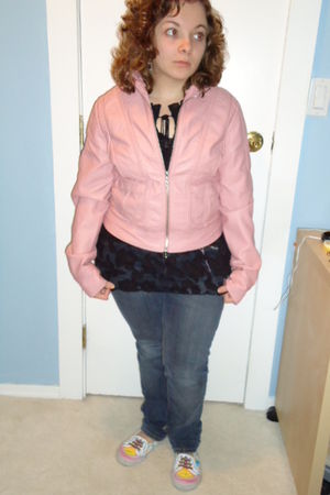 pink jacket - black top - blue jeans - white shoes
