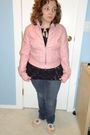 Pink-jacket-black-top-blue-jeans-white-shoes