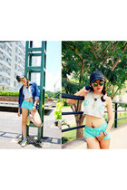 silver cropped top - black leather hat - blue denim shirt - aquamarine shorts