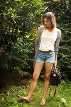black bag - light blue shorts - white top - tan loafers - silver cardigan