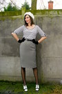 Camel-coat-black-tights-white-t-shirt-gray-skirt-white-heels-black-glo