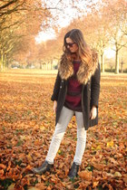 black coat - maroon sweater - off white pants