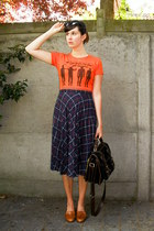 black bag - tawny loafers - navy skirt - carrot orange t-shirt