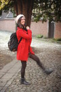 White-sweater-black-boots-red-coat