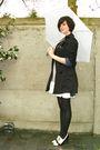 Black-coat-blue-dress-white-shoes-blue-necklace-blue-cardigan-black-br