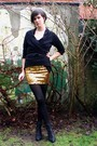 Gold-skirt-black-top-black-tights-black-boots-green-accessories