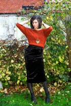 black skirt - burnt orange sweater - black boots - black tights - gold accessori