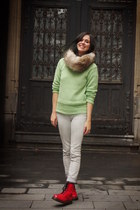 lime green sweater - red boots - off white pants