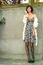 Black-dress-white-cardigan-black-tights-black-shoes-silver-accessories