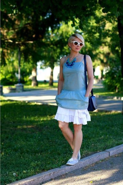 navy Furla bag - white e2o skirt - sky blue tezenis top