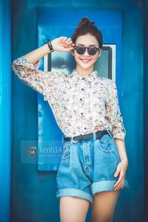 light pink shirt - sky blue shorts - black sunglasses