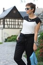 White-westrags-shirt-sky-blue-clutch-bag-black-yest-pants