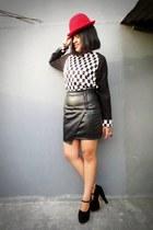 checkered Gaudi dress - bowler unbranded hat - leather wrap Gaudi skirt