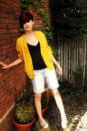gold cardigan - black t-shirt - blue jeans