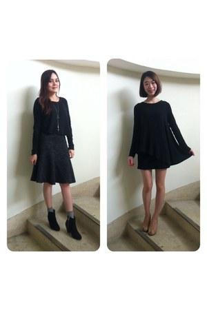 black knitted top - black top - heather gray socks - neutral heels