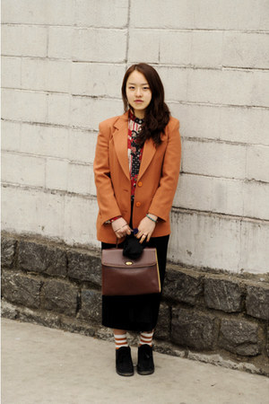 carrot orange jacket - black skirt