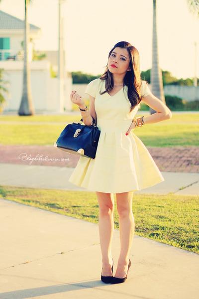 black bag - light yellow dress - black pumps