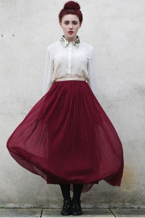 pleated skirt - lace up boots - studded belt - sequin blouse
