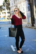 black Cuyana bag - brick red Tobi sweater - black J Brand pants