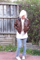 white band t-shirt - light blue jeans - brown leather jacket