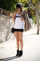 black leather shorts - tan trench coat - white aint no wifey top