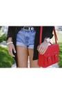 Red-bag-black-polka-dot-blouse
