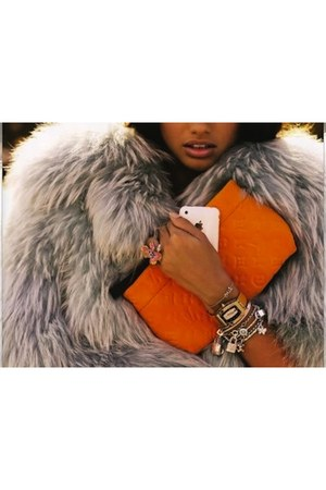 Louis Vuitton bag - fox fur shag jacket - white gold Cartier bracelet