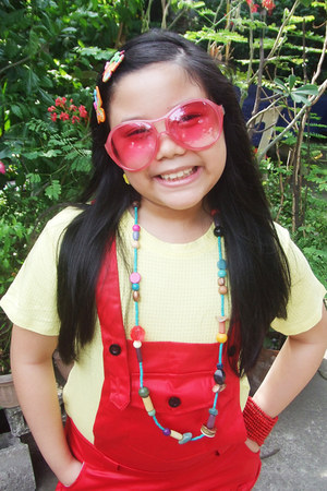 red wooden beads bracelet - light yellow shirt - hot pink oversized sunglasses