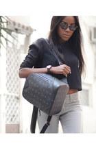 black leather MCM bag - periwinkle Lee jeans - black Cut Cuutur sweatshirt