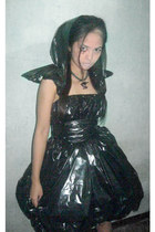 real bugs head necklace - trash bag dress - black heels heels