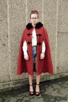 blue shorts - brick red cape - burnt orange cape
