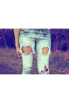 light blue torn fishbone jeans
