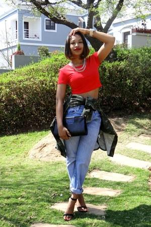 crop top top - Levis jeans - camo shirt shirt - heels