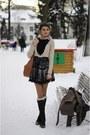 Dark-brown-boots-brown-coat-black-shirt-peach-blouse-neutral-accessories
