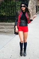 black boots - black jacket - black shirt - red scarf - black bag - red shorts