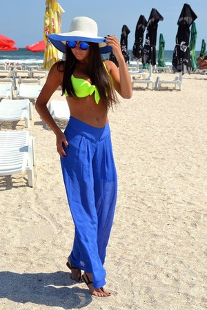 hat - sunglasses - blue pants - swimwear - sandals