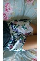 deep purple floral Harmony  Havoc shorts - black clutch Cole Haan bag