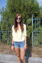 black bracelet - light yellow H&M shirt - blue unknown shorts - gold watch