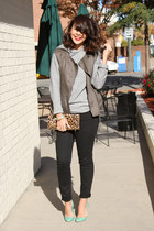 black skinny American Eagle jeans - light brown leopard Clare Vivier bag
