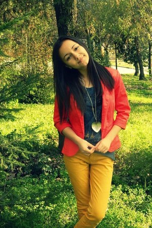 long heart necklace - red molded jacket - gold pants - navy long large t-shirt