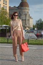 light pink Front Row Shop top - red Michael Kors bag