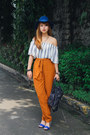 Blue-stradivarius-hat-navy-balenciaga-bag-burnt-orange-sfera-pants
