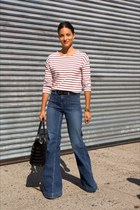 black bag - navy flare leg jeans - black belt - white striped top