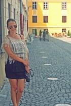 ivory top - dark gray bag - camel sunglasses - black New Yorker skirt