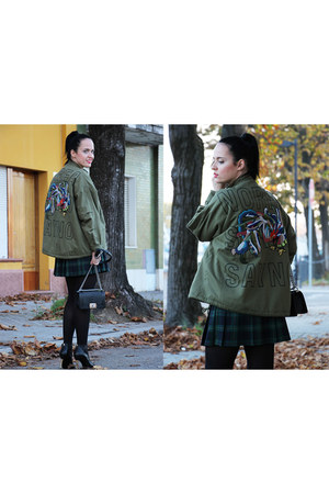 black Chanel boots - army green essentiel Antwerp jacket - black Chanel bag