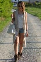 dark brown strategia boots - ivory Prada bag - teal denim True Religion shorts