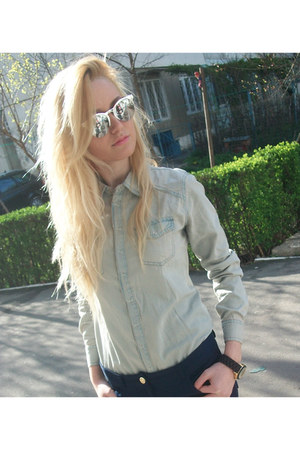 light blue shirt - silver sunglasses - navy pants