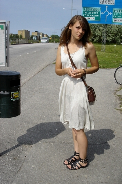 Girl by the bus stop